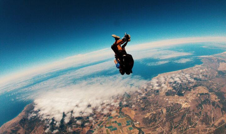 Person skydiving at daytime.