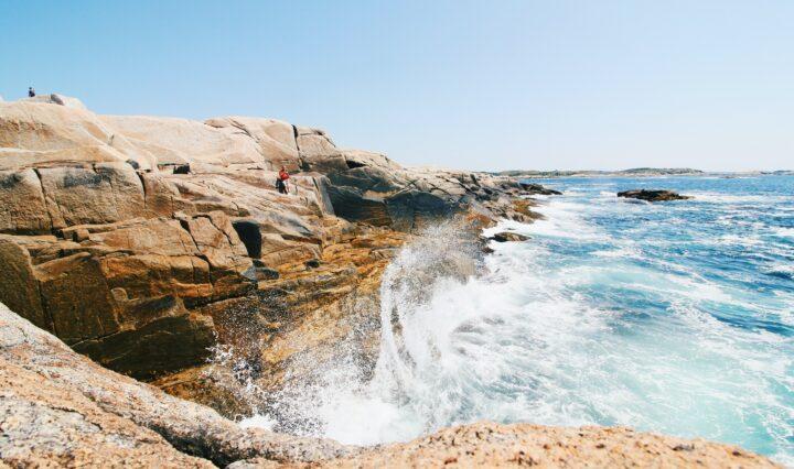 Waves crash upon a shore of a coastal area in Nova Scotia, Canada