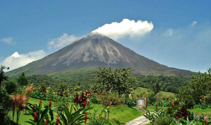 Arenal Volcano towering over the lush green countryside