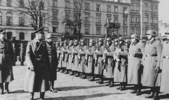 The German Order Police under Nazi officials' inspection.