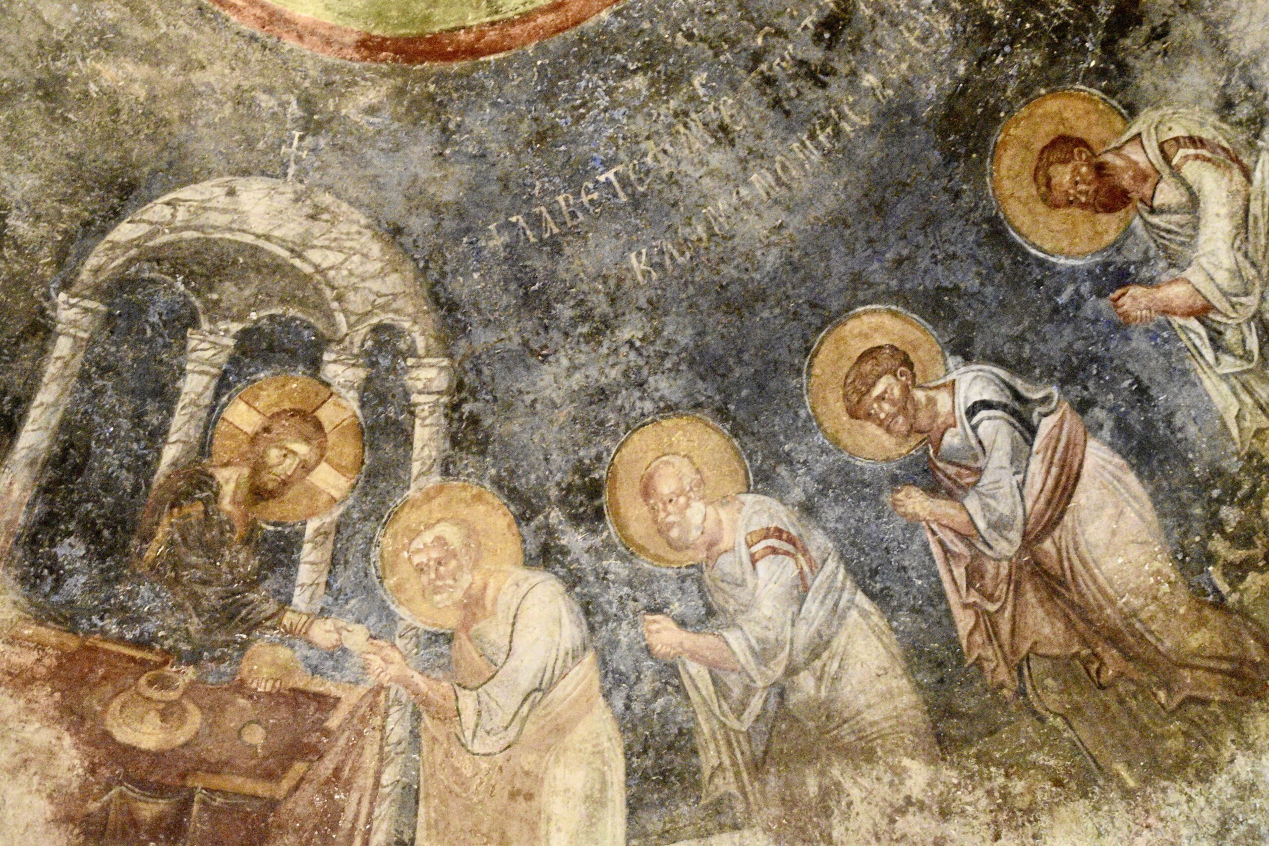 1500 year old fresco showing Jesus blessing apostles with halos