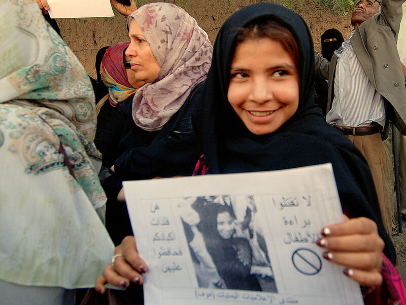 Nujood Ali demonstrates outside parliament in San'a, Yemen, on March 23 in support of proposed legislation banning the marriage of girls under 17