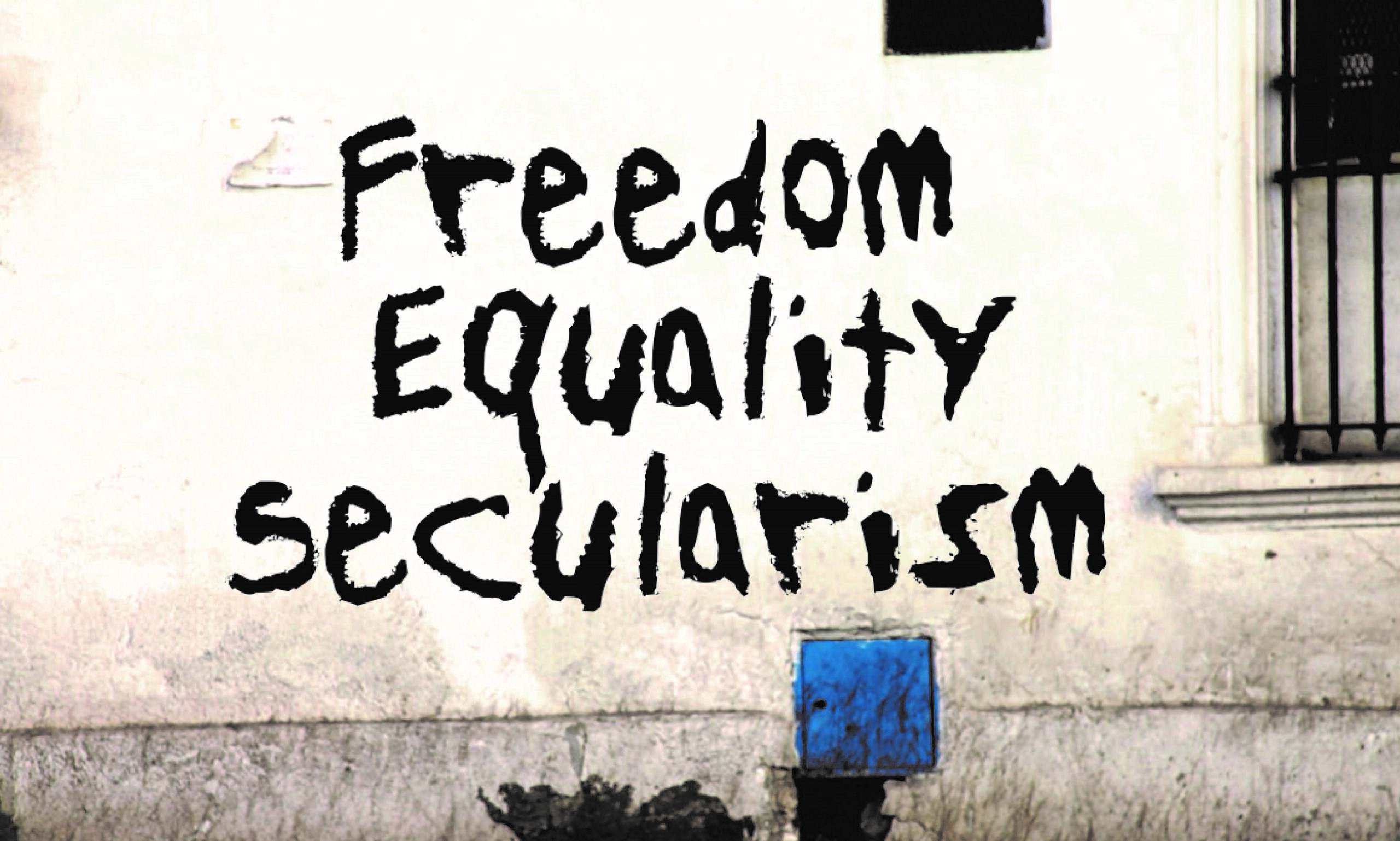 """Image of writings on the wall saying ~""""Freedom, Equality, Secularism"""""""