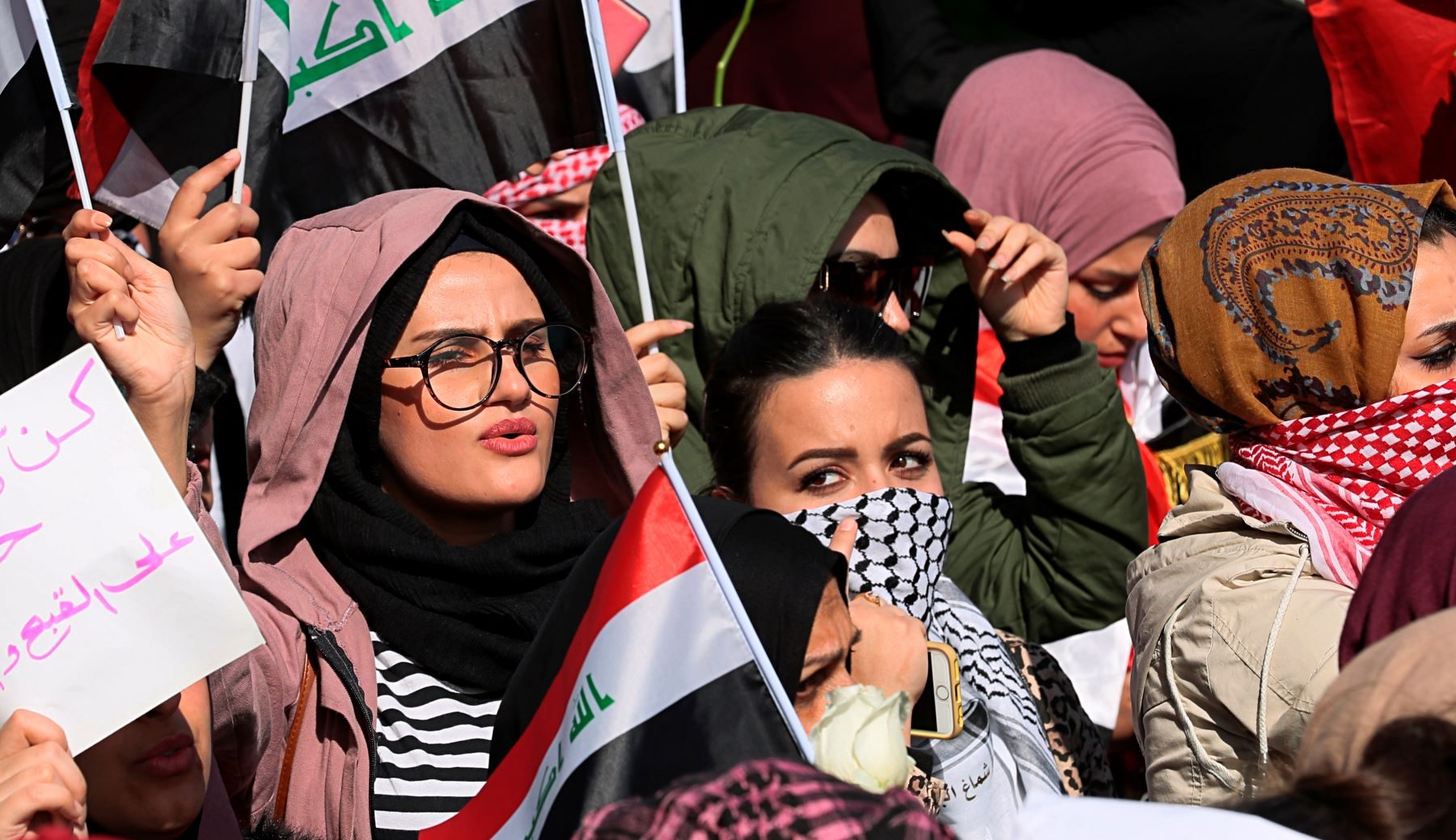 Women in Iraq protest against gender violence.