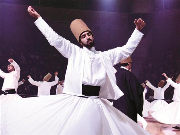 An image of whirling Sufis.