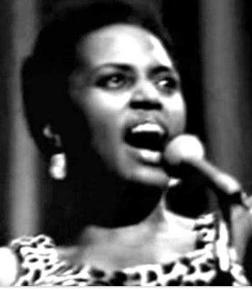 Mirriam Makeba singing on the Mic.
