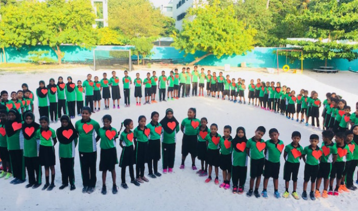 WHD-kids forming a heart