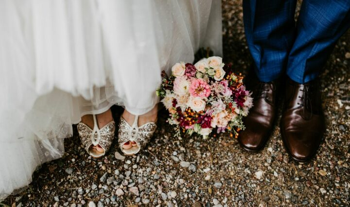 Photo of a wedding pointed down at the feet of bride and groom