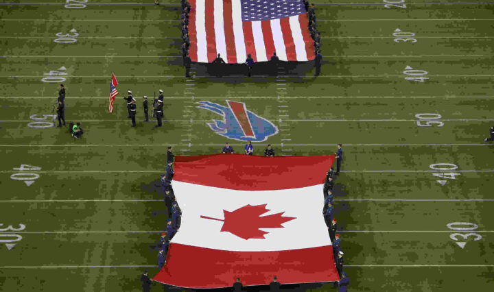 The American and Canadian flags unfurled during an NFL game