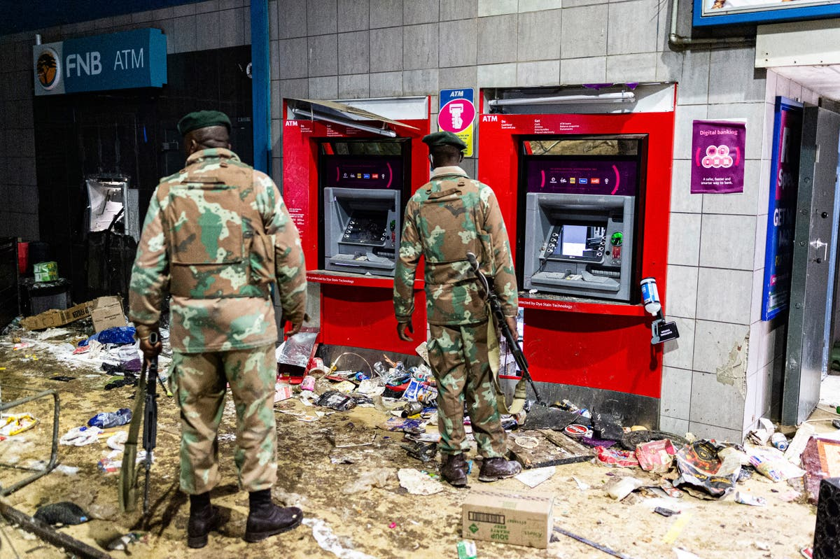 solders holding guns trying to stop the looting