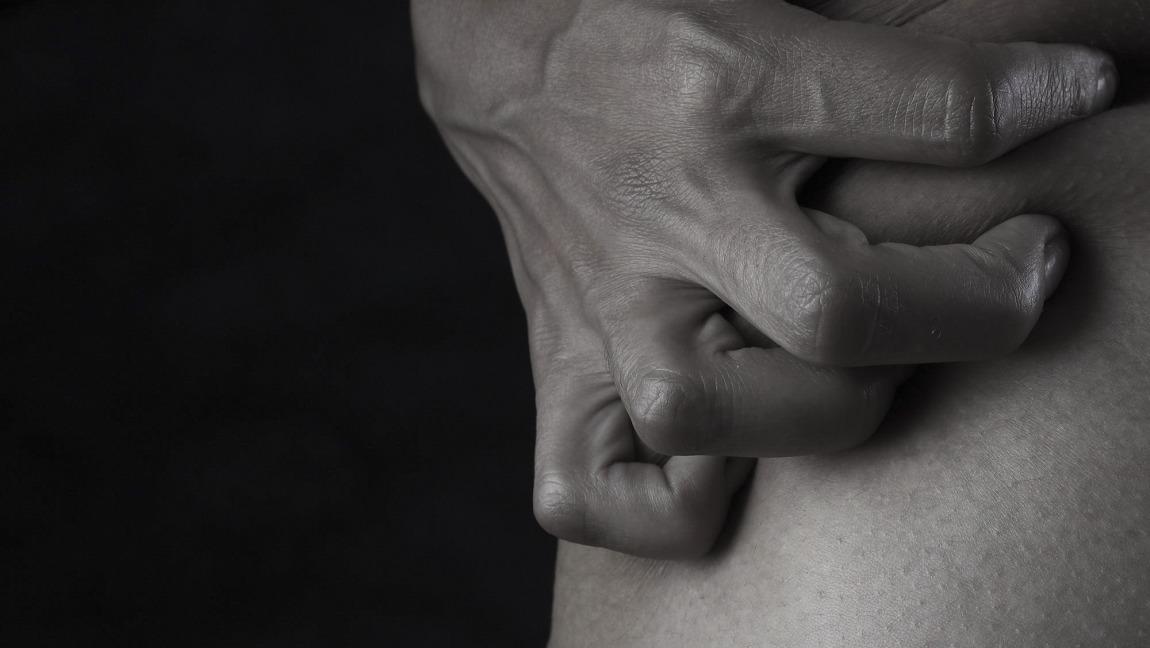 Hand clutching skin